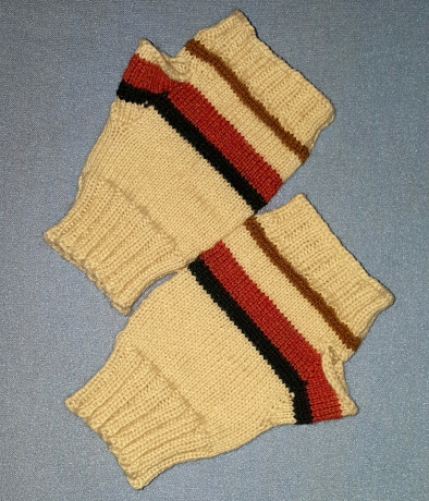 Off-white fingerless gloves with black, rust, and brown stripes on a light blue surface.
